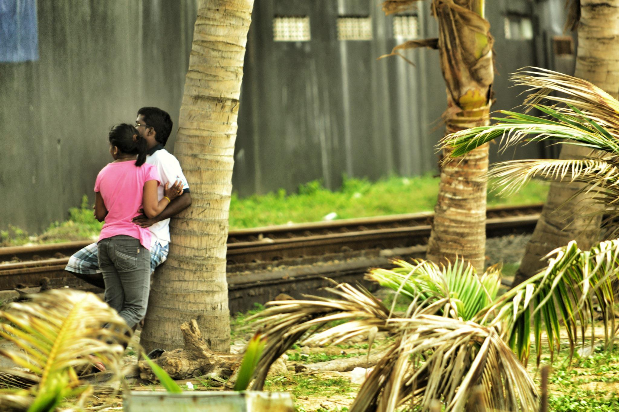 Couples in Colombo romance by the railway track