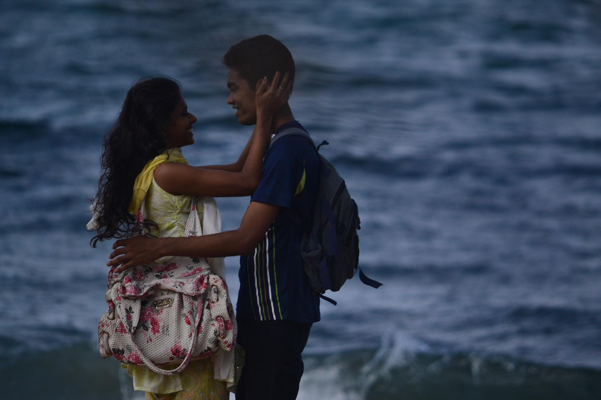 Couples romancing in Colombo by the Sea