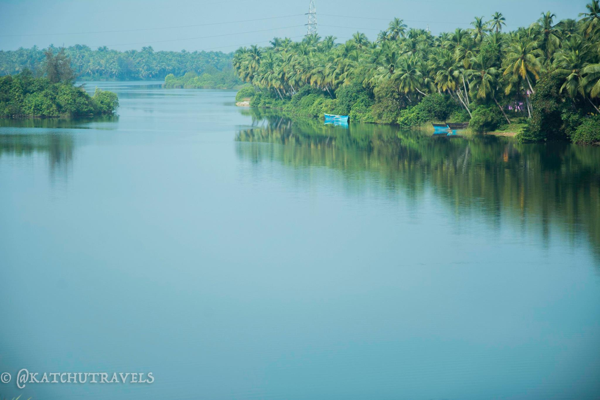 Serene views of a waterbody on the Konkan Railway route