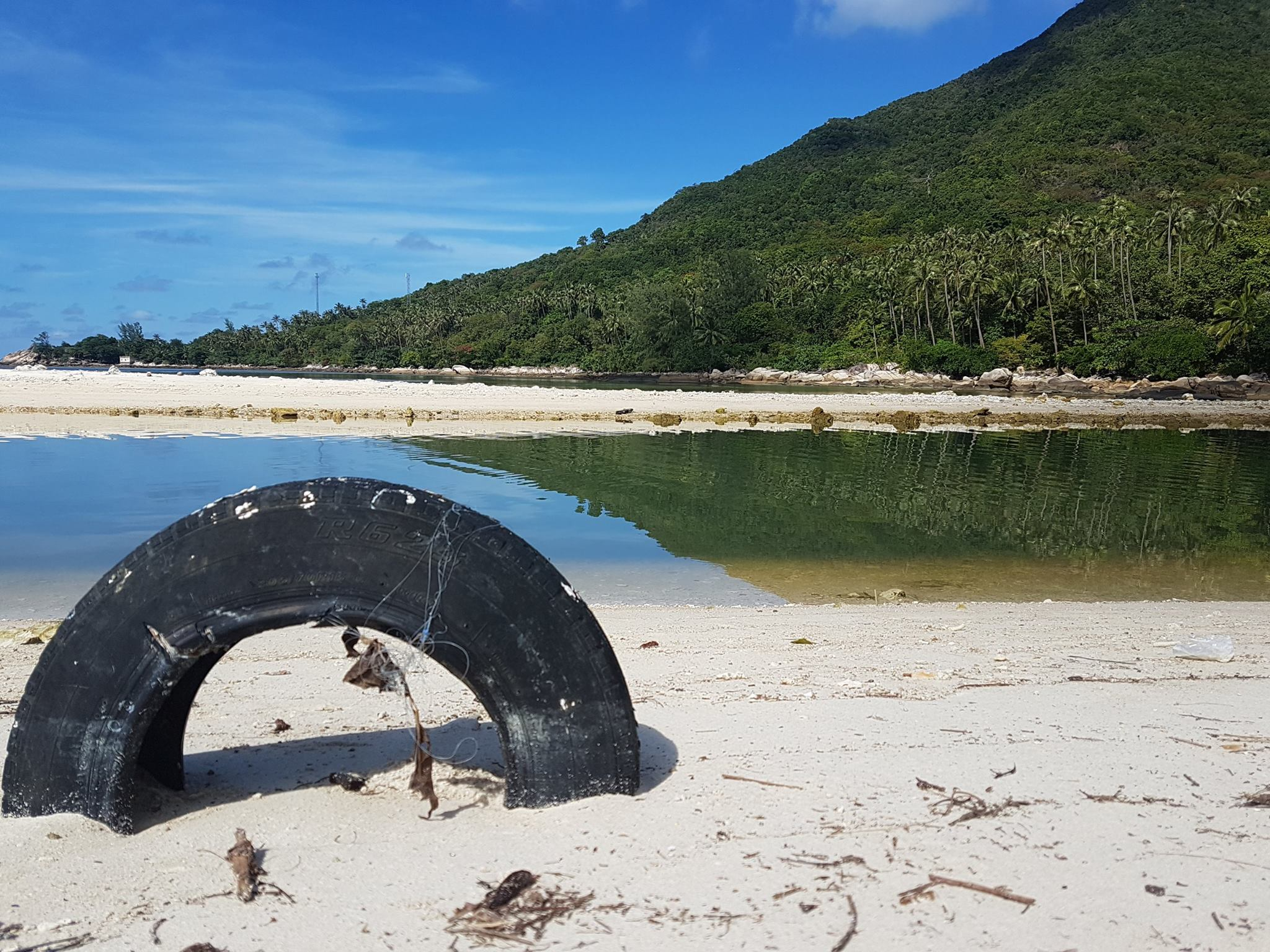 A tyre buried in the sand at Chaloklum-Koh Phangan