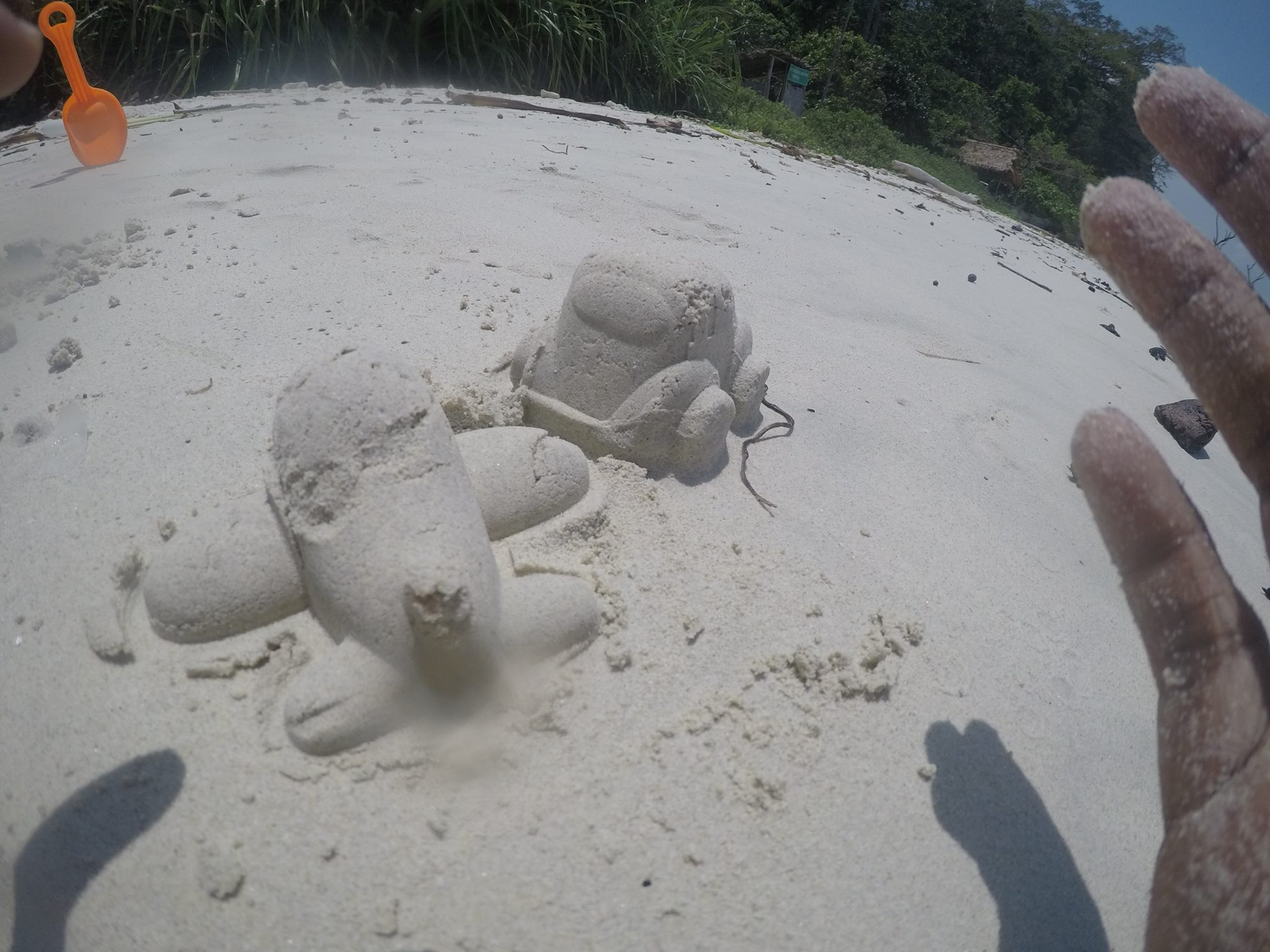 Motion on the Beach-Sand art for an airplane and car-Kalapathar Beach in Havelock Island-India
