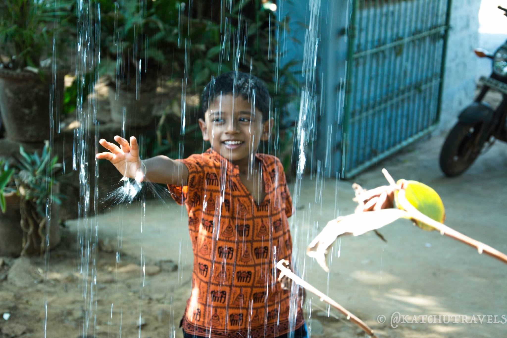 Nandu playing around with the water fountain at 'The Space' in Goa