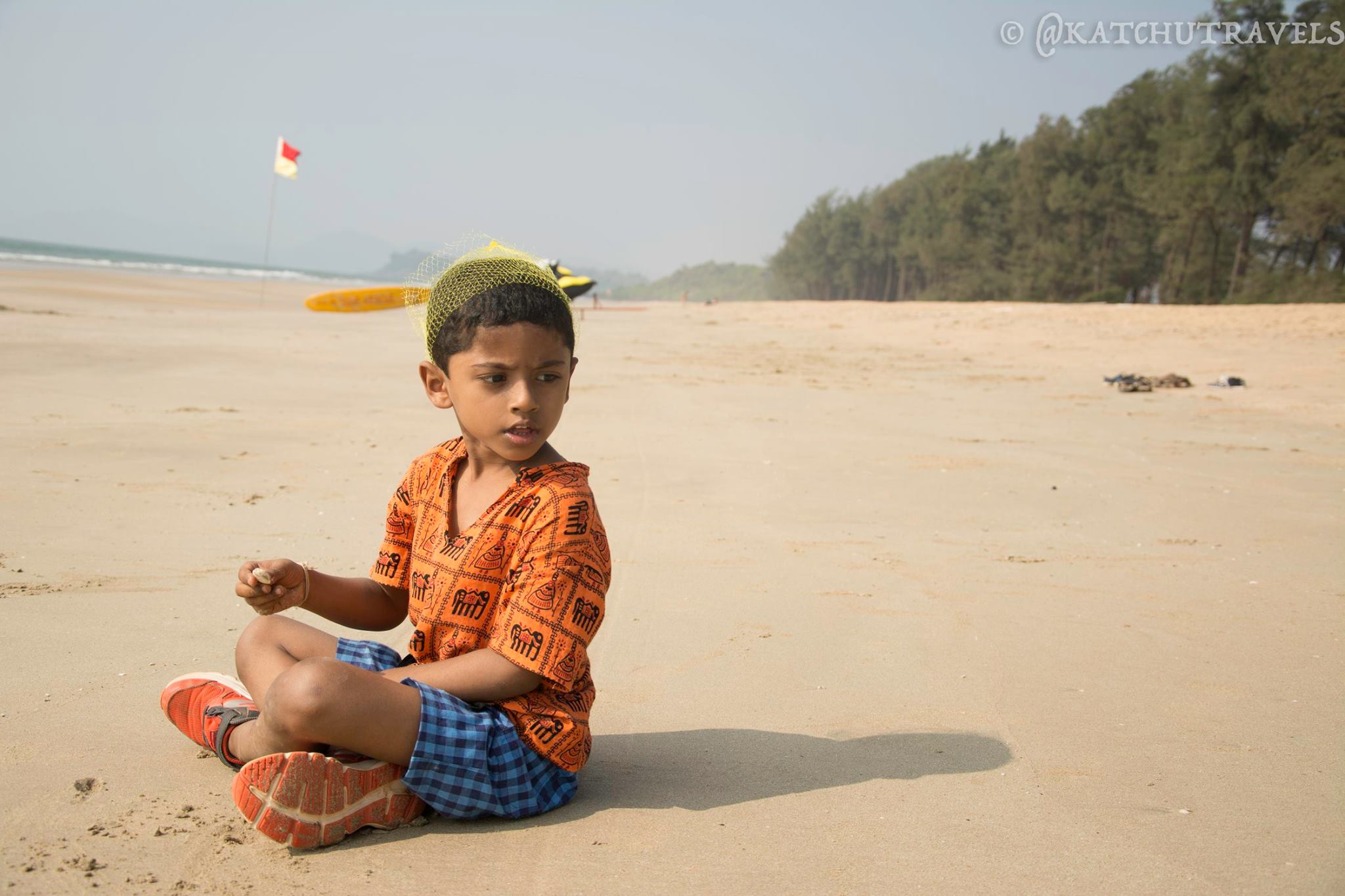 Nandu spending time collecting shells at Galjibag beach (South-Goa in India)