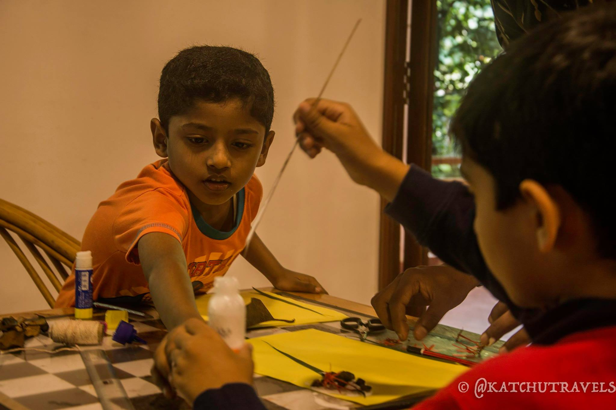 Nandu reaching out for the adhesive at the Children-Activity center at Kurumba Village Resort