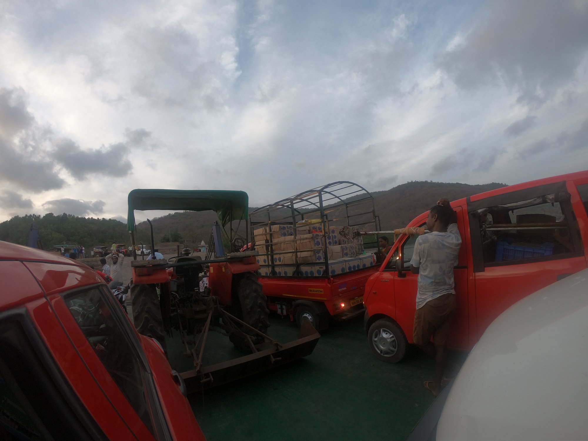 Vehicles behind me and front of me in the Bagmandala Ferry