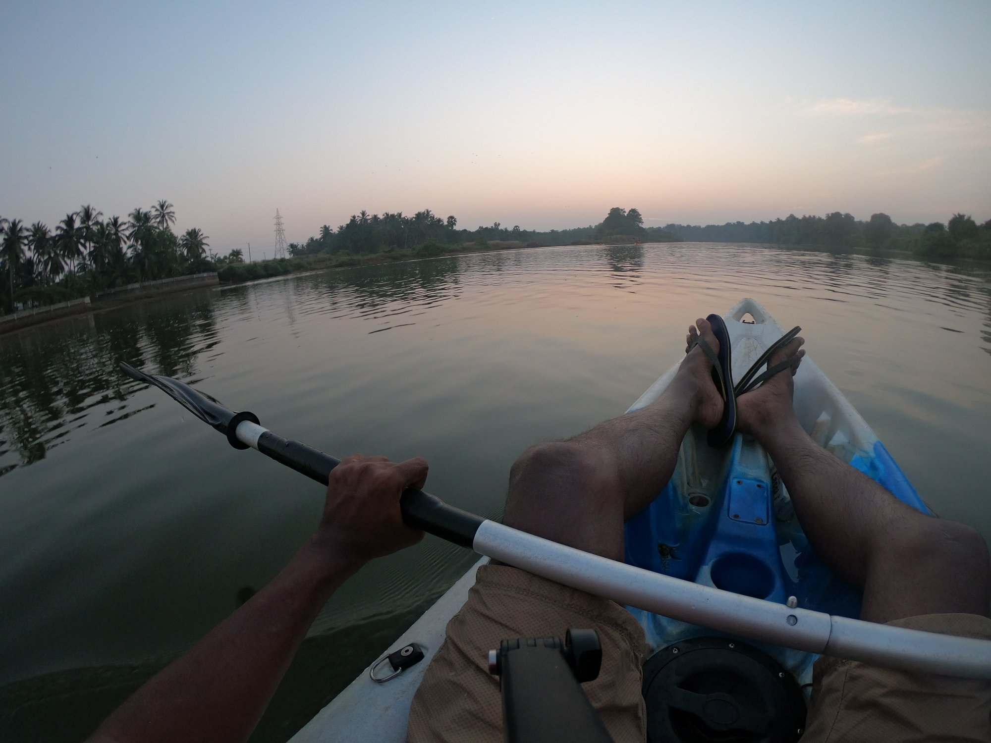 Paddling back to the camp at Mulki